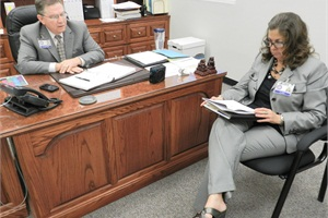 Rike and Mike Simpson, chief of operations for Shelby County Schools, meet over the phone with Larry Riggsbee, executive director of the Tennessee Association of Pupil Transportation.