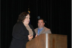 During the NAPT awards banquet, Lydia Poland Hancock accepted the Heroism Award on behalf of her father, Alabama school bus driver Charles Poland, who was fatally shot in the line of duty. Also pictured is Hancock's husband.