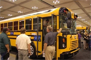 At the trade show, Blue Bird unveiled its 2014 All American Type D school buses, pictured here. Company officials said that features include superior fuel efficiency, turning radius, driver visibility and paint warranty.