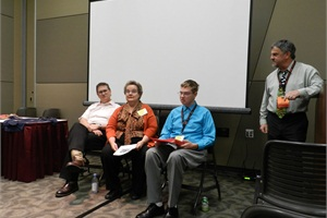 Pete Meslin (far right), director of transportation at California's Newport-Mesa Unified School District, moderated a session at the NAPT Summit in which panelists (from left) Michael and Judith Ann Benedict and their son, Michael Jr., discussed how relationship-building is critical to good customer service when transporting special-needs students.
