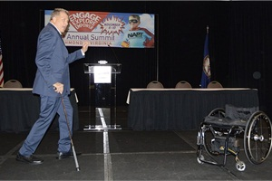 """After speaking from his wheelchair for much of his presentation, Burrows surprised the audience by standing up and walking — which a doctor had told him he wouldn't be able to do again after the accident. """"Never let something that someone else believes paralyze you from achieving those things in your life that you might be able to achieve,"""" Burrows said."""