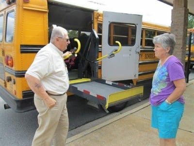 Frederick County (Md.) Public Schools bus driver Frank Abrecht inspects a wheelchair lift with instructional assistant Lois Cowles.