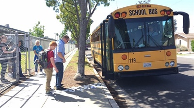 Special-needs students at Newport-Mesa USD wait to climb aboard the bus for the ride home.
