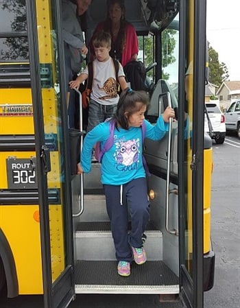 The fifth and final program session involves community-based instruction where the bus delivers students to their bus stops to practice essential skills, oftentimes with the assistance of parents.