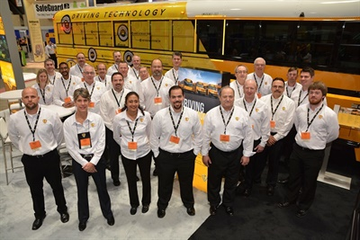 Trish Reed, vice president and manager for IC Bus, is shown here in the front row, second from the left, with team members at the 2018 National Association for Pupil Transportation Trade Show.