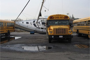 In Coney Island, boats from nearby marinas landed in bus yards. In the case pictured here, the boat's bow pierced a bus, causing major damage.