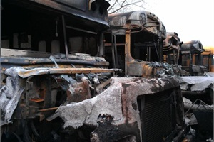 In some yards, buses were destroyed when salty floodwaters sparked vehicle electrical fires.