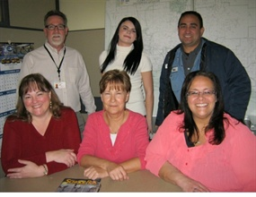 ESD 112's transportation cooperative staff comprises a total of 62 employees. Pictured in the back row are Director Patrick Bonin, student intern Torre Jones and mechanic Allen Van Every. In the front are dispatcher Kathy Steinbarge, driver trainer Ingrid Goffic and accountant Ti'a Kanekoa.
