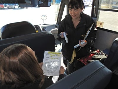 Trainees must show that they know how to read and carry out a doctor's order, such as administering Diastat, medication for seizures. Here, a driver takes refresher training with Teena Mitchell (right), special-needs transportation coordinator.