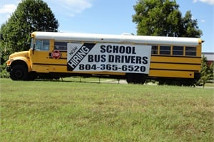 School buses with banners that serve as billboards are stationed throughout Hanover County, Virginia.