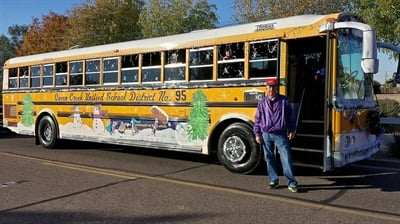School bus drivers for Queen Creek Unified School District in Arizona often dress up in holiday-themed costumes to lighten up the bus ride. Shown here is Edd Hennerley, the district's director of transportation, standing ready to drive students to and from school in holiday style.