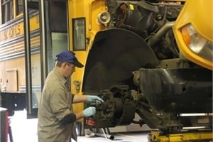 Technicians at Salem-Keizer Public Schools in Salem, Ore., undergo mentored training before working on buses by themselves.