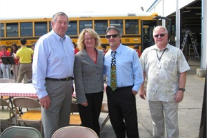 Pete Meslin (in the blue shirt and wearing a tie), director of transportation at California's Newport-Mesa Unified School District, is pictured with current and former school board members and transportation department personnel at a bus driver appreciation event.