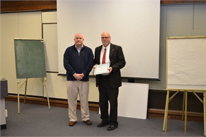 Michael Shields (right), director of transportation and auxiliary services for Oregon's Salem-Keizer Public Schools, says vetting information with executive-level individuals prior to presenting at a board meeting will help in understanding the board's position on specific topics. Shields is pictured with school board Chairperson Jim Green accepting the 2013 Dennis Essary Leadership award.