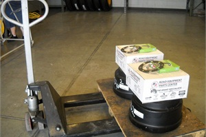 Since brake drums are heavy, School District of Manatee County's parts department places them on palates with the corresponding brake shoes located on shelves directly above them.