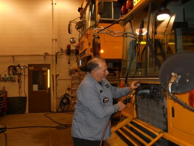 James Flauto, the vehicle maintenance foreman for Brecksville-Broadview Heights City School District, works on one of the district's 47 school buses. His team recently saw a significant drop in regeneration incidents.