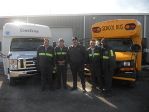 The shop team includes technicians Damian Damianos and Don Menegon, Shop Manager Cray Pulaski, Fleet Maintenance Supervisor Mark R. Egan, and Willie McInstosh, who oversees utility services.