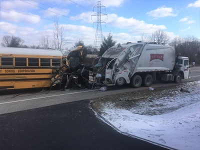 The driver was driving too fast and experienced a glare from the sun before the bus collided with the garbage truck, according to the crash report. Photo courtesy Indiana State Police