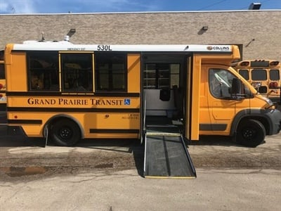 John Benish Jr., president and chief operating officer for Cook-Illinois Corp., says that the Low-Floor Bus helps to mainstream students who use wheelchairs. Shown here is one of Cook-Illinois Corp.'s two new Low-Floor Buses.