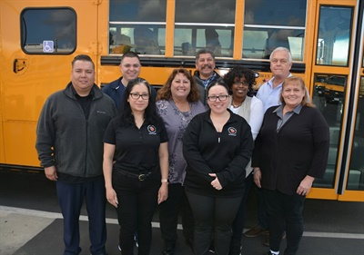 Pam McDonald, director of transportation for Orange (Calif.) Unified School District, shown second row wearing purple, is in the midst of succession planning. She expects all staff members to mentor promising employees.