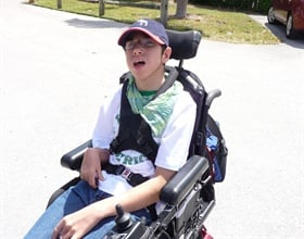 Jonathan is a high school student with cerebral palsy who uses a wheelchair for his mobility.
