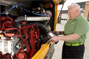 Fred Matlack, manager of fleet maintenance at Missouri's Parkway School District, does a final engine inspection on one of the district's new compressed natural gas buses before assigning it to a driver.