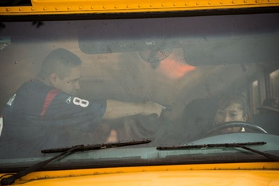 If an intruder succeeds in boarding the bus, the driver should demonstrate a willingness to listen and be calm. Pictured here is an armed intruder training that took place at Houston (Texas) Independent School District.