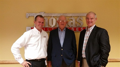 Caley Edgerly (left), current president and CEO of Thomas Built Buses, is seen here with former company leaders John Thomas II and John Thomas III.