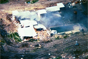 During the Waco siege in 1993, Charley Kennington, then a local transportation director, was recruited to drive a bus with an ATF agent to the Branch Davidian compound. Unfortunately, before they arrived, cult leader David Koresh reneged on releasing children. Here, the compound is seen on fire days later.