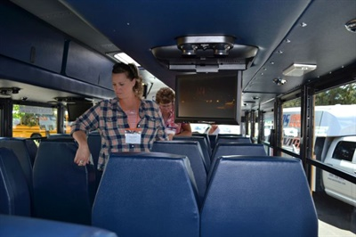 Eugene's yellow charter buses boast such features as charter-style seats, overhead storage bins and lights, and flip-down DVD screens. The bus seen here was on display at the Oregon Pupil Transportation Association conference in Bend last summer.