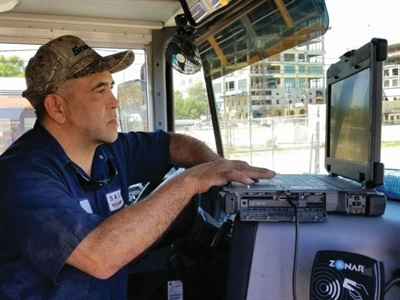 A San Antonio (Texas) ISD mechanic sets the governor, also known as a speed limiter, on a school bus. The district keeps it set at 50 mph to ensure fuel isn't being wasted.