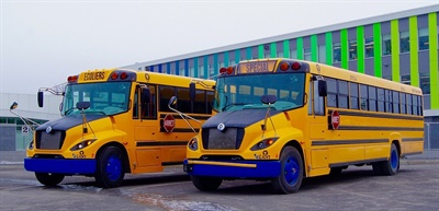 Lion Bus plans to add a new electric bus manufacturing facility in California, with support from the state and the Canadian province. Shown here are two eLion buses in Quebec.