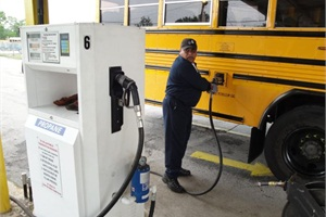 Houston ISD received grants for 27 propane buses and a fueling station. Here, Ramon Vazquez fills one of the buses with the alternative fuel.