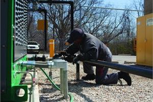 Quinton Zenon, a utility mechanic for Kansas City (Kan.) Public Schools, performs maintenance on the district's CNG compressors.