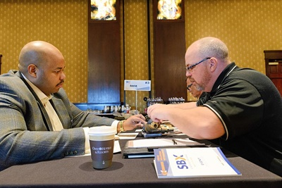 Forrest Tarver (left) of the School District of Philadelphia meets with Patrick Foley of Ametek.