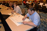 Daniel Higbie of Student Transportation of America serves as scribe for the roundtable on driver shortage.
