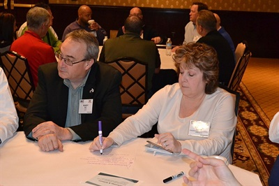 Cheryl Fisher from Fauquier County (Va.) Public Schools and Randy Ray from IC Bus take part in a roundtable discussion.