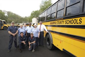 Key transportation staff members at Kanawha County Schools include (from left, standing) Orville Fields (service tech crew leader), Linda Ball, Eddie Metten, Willie Schofield, Jackie Kay (drivers) and George Beckett (transportation director). Kneeling are Clayton Means and Mark Byrd (service technicians).