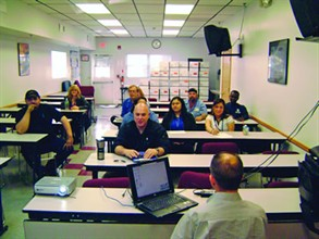 The Trans Group staff in Spring Valley, N.Y., has technology installed and upgraded in the summer. Here, maintenance supervisors and clerks attend a training session for an update made to the maintenance software the contractor uses.