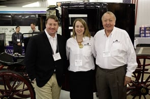 Richard Wolfington Sr. (right) is pictured with son Richard Wolfington Jr. and daughter Eganne Wolfington McGowan in front of a restored 1898 Wolfington Brougham carriage.