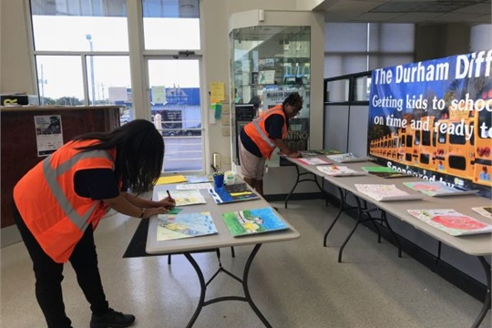 Durham staff members display posters for the 2017 contest.
