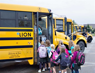 """Schmitty & Sons is running an eLion electric school bus. """"There really haven't been any major issues or things that are out of the ordinary … so we've been extremely happy with that so far,"""" Mike Forbord says."""