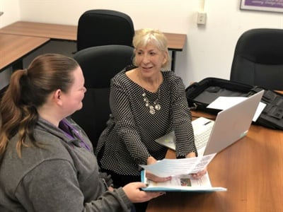 After retiring as a transportation director and becoming a consultant, Judith Clarke (right) formalized a program for retraining school bus drivers and attendants. She is seen here with Ashley Bednarz, a bus aide at Hannibal (N.Y.) Central School District.
