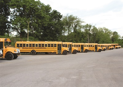 Reliance Student Transportation's fleet includes IC Bus diesel-powered Type Cs, Blue Bird FE diesel buses, Collins minibuses, and Ford 10-passenger transit vans.