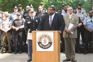 "NHTSA Administrator David Strickland (at podium) speaks at a ""Click It or Ticket"" event last year. At right is U.S. Transportation Secretary Ray LaHood."