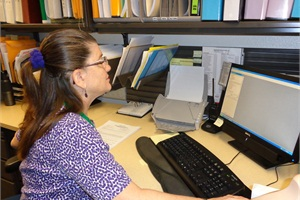 As part of the Mesa (Ariz.) Public Schools transportation department's project to go paperless, retired staff members work part time to scan documents into a cloud.