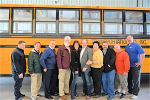 Pictured from left are AA Transportation drivers Hector Vazquez, Mike Ciesluk, Jose Blanco and Edward Bourgault; Julie D'Ambra, director of HR and safety; Ron Ernenwein, president and CEO; and drivers Blanca Lugo, Todd Williams, Robert Amadei and William Hogan.