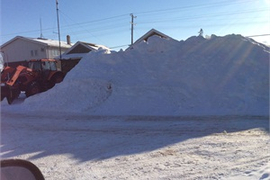 Piles of snow like the one pictured at the company's Arva, Ontario, location also contributed to the halt in service, but when buses did run, the company's team worked together and focused on safely transporting students.