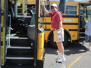 Student Transporter Bill Giaquinto works tomaintain his bus in accordance with districtguidelines.