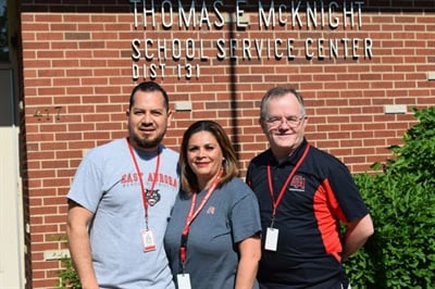 Assistant Director Walter Doughty (right) leads East Aurora's transportation team, which includes José Juárez, transportation specialist, and Sonia Magana, transportation secretary.